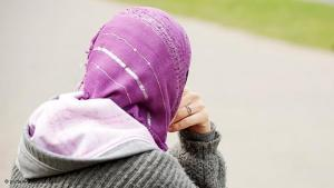 Young Muslim woman wearing a headscarf and a 'hoodie' (photo: dpa)