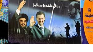 Poster of Syria's President Bashar al-Assad and Hezbollah chief Hassan Nasrallah (photo: picture alliance/ZB)
