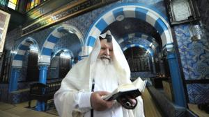 Israeli Rabbi Maimoun, 67, from Tel Aviv and born in Tunis, reads the Torah in the Ghriba Synagogue on April 29, 2010 on the eve of the Jewish annual pilgrimage in Djerba (photo: Fethi Belaid/AFP/Getty Images)