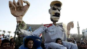 Demonstraters carry a puppet representing Egyptian President Morsi on Cairo's Tahrir Square (photo: Reuters)