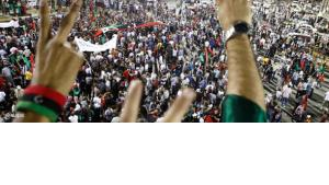 Libyans flash V signs as hundreds demonstrate against Muammar Gaddafi at Green Square in Tripoli, Libya, early Tuesday, 30 August 2011 (photo: dapd)
