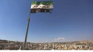 Rebel Flag over Aleppo (photo: AP)