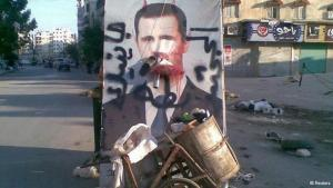 A defaced poster of President Assad in Aleppo (photo: Reuters)