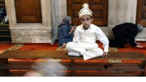 A Turkish boy in traditional circumcision costumes at a mosque in Istanbul (photo: AP)