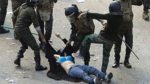Egyptian army soldiers drag a female protester along the ground during clashes at Tahrir Square in Cairo in December 2011 (photo: Reuters)