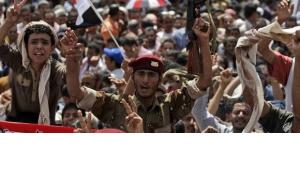 A jubilant crowd in Yemen's capital, Sanaa, after the news broke President Saleh had left the country (photo: AP)
