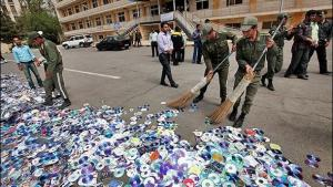 Officials sweeping up CDs and DVDs in Iran (photo: MEHR)