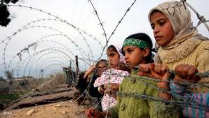 Palestinian children at the Palestinian-Egyptian border (photo: AP)