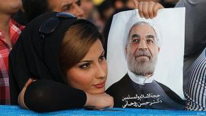 Iranian woman holding a poster of Hassan Rouhani (photo: FARS)