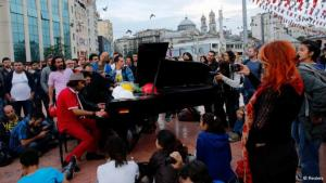 Davide Martello playing his piano in Taksim Square, Istanbul (photo: Reuters)