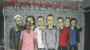 Ahmed Maher at the office of the April 6 movement in Gizeh. The graffito in the background displays the so-called 'martyrs of the revolution', including Khaled Said (center) (photo: © Markus Symank)