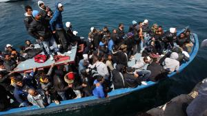 Refugee boat at the coast of Lampedusa, Italy (photo: dpa/picture-alliance)