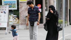 A Muslim family in Switzerland, the woman wearing a niqab, a full face veil (photo: imago/Geisser)