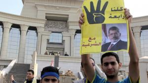 Supporters of Morsi in front of Cairo's High Court (photo: Mohamed Kamel/AFP/Getty Images)