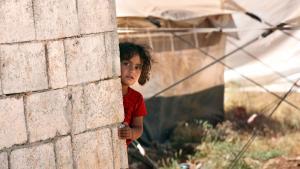 A Syrian child in a refugee camp on the Syrian border (photo: dpa/picture-alliance)
