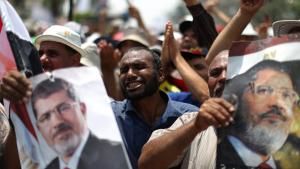 Egyptian supporters of deposed president Mohamed Morsi (portrait) shout slogans during a rally in support of the former Islamist leader outside Cairo's Rabaa al-Adawiya mosque on July 9, 2013 (photo: AFP/Getty Images)