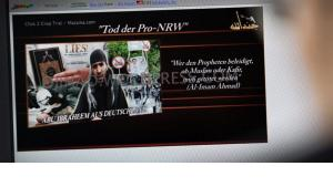 Abu Ibraheem in a video message threatening to kill people who allegedly denigrate prophet Muhammed (photo: picture-alliance/dpa)