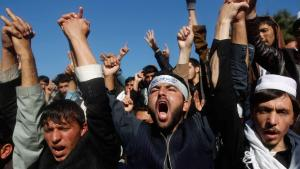 """Students shout anti-government and anti-U.S. slogans as they protest against the national gathering called a """"loya jirga"""", in Jalalabad, eastern Afghanistan November 19, 2013. The students expressed their concern about a proposed Bilateral Security Agreement (BSA) between Afghanistan and the U.S. (photo: REUTERS)"""