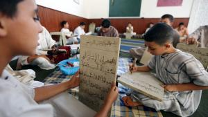 Libyan children write on wooden slates as they work to memorize verses from the Koran at a Koranic school during the Muslim fasting month of Ramadan, on July 20, 2012 in the Libyan city of Tripoli (photo: Mahmud Turkia/AFP/Getty Images)