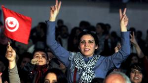 A Tunisian woman gives the victory sign with both hands during a memorial service for the murdered opposition politician Chokri Belaid in Tunis (photo: EPA/MOHAMED MESSARA)