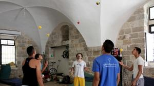 Young men practice juggling (photo: Palestinian Circus School)
