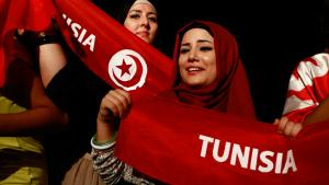Women in headscarves demonstrating in Tunis (photo: Reuters)