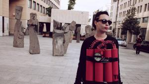 Artist Rima Najdi wearing a fake explosive belt in Beirut on 12 January 2014 (photo: Maria Kassab)