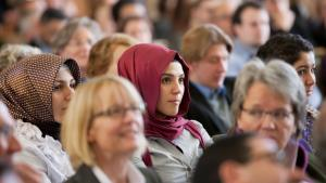 Two young Muslim women attend a ceremony at the Westfälische Wilhelms University in Münster in October 2012 (photo: dpa/picture-alliance)