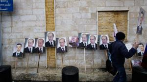 Pictures of Vladimir Putin and Bashar al-Assad leaning against a wall outside the Russian embassy in Damascus waiting to be used in a pro-Assad demonstration (photo: Muzaffar Salman/AP/dapd)