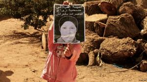 A girl holds up a poster of Amina al-Filali, victim of rape and forced marriage in Morocco (photo: Naqi Tbel)