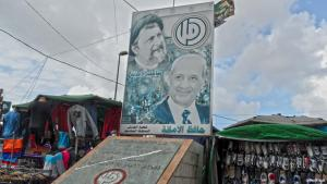 A political poster hanging in a market in Lebanon (photo: Ben Knight)