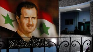 A poster with an image of Syrian President Bashar al-Assad in front of the Syrian flag (photo: Reuters)