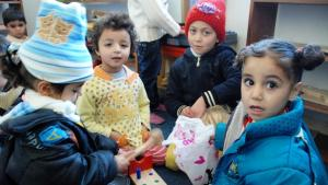 Children playing in the kindergarten for traumatised children in Manshia, Syria (photo: Laura Overmeyer)