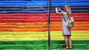 A woman photographs one of Istanbul's new rainbow steps (photo: AFP/Getty Images)