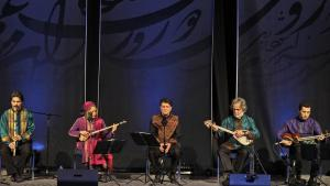Mohammad-Reza Shajarian (centre) performing on stage with the Shahnaz Ensemble in Dubai in February 2011 (photo: AP)