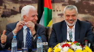 Hamas chief Ismail Hanija (right) and Fatah representative Azzam al-Ahmed in Gaza City on 23 April 2014 (photo: Reuters)
