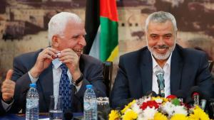 Hamas chief Ismail Hanija (right) and Fatah representative Azzam al-Ahmed in Gaza City on 23 April 2014 (photo: Reuters)