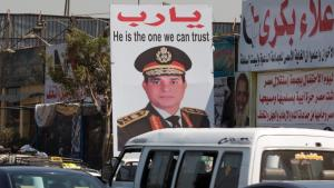"An election poster for Abdul Fattah al-Sisi in Cairo that reads ""He is the one we can trust"" (photo: SN/APA (DPA)/MICHAEL KAPPELER)"