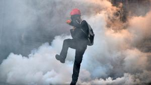 A demonstrator kicks a tear gas canister back to riot police during an anti-government protest in Ankara on 31 May 2014 (photo: Reuters)