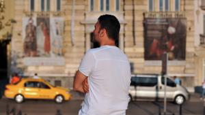 Ertugrul, president of a Muslim homosexual association in Turkey, stands near the Istiklal Avenue as he poses for a photograph in Istanbul on 28 July 2013 (photo: OZAN KOSE/AFP/Getty Images)