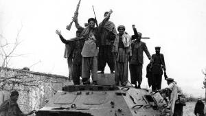 Jubilant mujahideen on a captured Russian armoured personnel carrier during the war between Afghanistan and the USSR (photo: Getty Images)