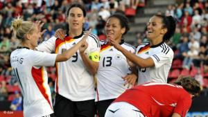 prominent examples: female footballers de Mbabi (2nd from right) and Bajramaj (right) are fully integrated into the German women national team (photo: dpa)