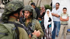 Members of the Israeli army carrying out a raid in Hebron on 21 June 2014 (photo: Reuters/Mussa Qawasma)