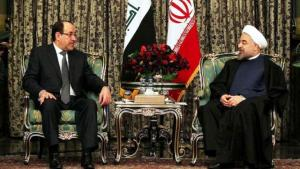 Iraqi Prime Minister Nouri al-Maliki (left) during a visit to President Hassan Rouhani in Tehran (photo: AFP)
