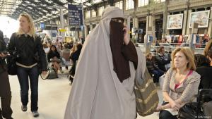 Fully-veiled woman in a Paris station. Photo: Getty Images