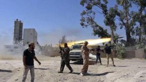 Members of an Islamist militia firing rockets at Tripoli Airport (photo: AP/dpa)