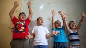 """Therapy: Syrian refugee children sing a song at the Karam Zeitoun School in Beirut. Creative activities are therapeutic for the children. """"They hear the stories of their parents. They talk about the war, about having no money. When they go to school, they can be themselves. They can be children,"""" says Charlotte Bertal, co-founder of a French NGO that runs the school."""