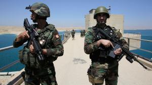 Kurdish Peshmerga fighters stand guard at Mosul Dam in northern Iraq, 21 August 2014 (photo: Reuters)