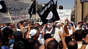 IS supporters in Mosul on 16 June 2014 (photo: picture-alliance/AP)