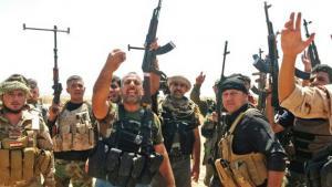 Kurdish Peshmerga and Shia volunteers in Iraq (photo: picture-alliance/dpa)